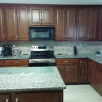 A kitchen island with granite counter tops we polished in irving Texas on 3/18/17