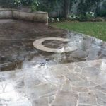 A half power washed outside patio we serviced on 5/12/19