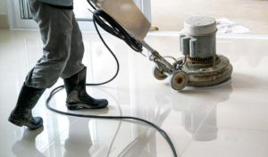 Commercial floor buffer cleaning an office floor