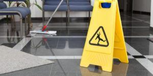 Sign cautioning people not to slip on a clean floor