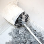 A dryer vent being cleaned by our equipment in Plano Texas