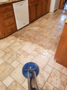 Cyclone Professional Cleaners cleaning a kitchen floor's tile and grout in Dallas Texas
