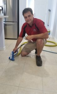Tile and grout being cleaned in a home