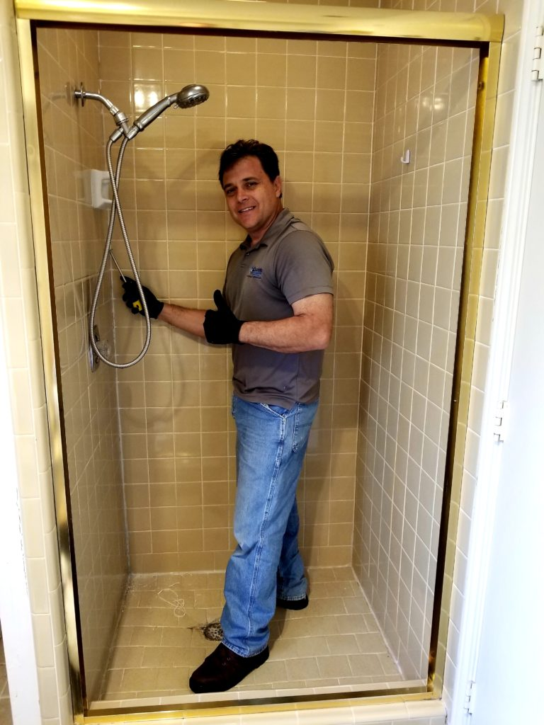 Frank Listorti cleans a shower at a home in Richardson. Texas
