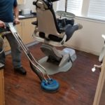 Wood floor cleaning and buffing in a dentist office near Dallas Texas