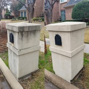 an a stone mailbox being cleaned with a power washer