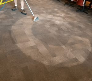 A man cleaning the carpets in a Plano Texas restaurant