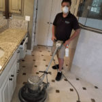 Wearing a mask while restoring a marble bathroom floor in McKinney Texas on 7/14/20